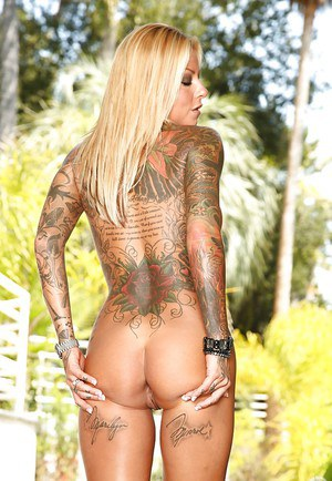 Milf babe with tattoo Brittany has big tits and a round big ass