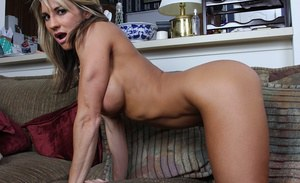 Pretty blonde milf with big tits spreading her pussy lips very wide