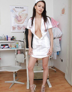 Stunning nurse brunette Belle spreading her mouth and pink pussy