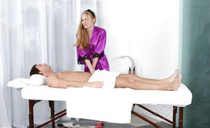 Massage blonde Avril Hall gives a good treat to her client