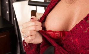 Big tit mature Lucy Heart licking her nipples and spreading pussy