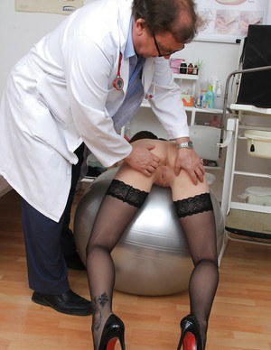 Fetish brunette Belle spreading her cute skinny pussy at the gyno doc