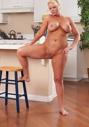 Jolly blonde Roxie Doll spreading shaved vagina in the kitchen