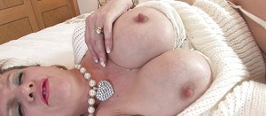 Lady Sonia prefers fingering and thinking of a big cock