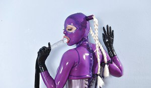 Latex slut Lucy loves a hardcore fetish with a toy in her tight pussy