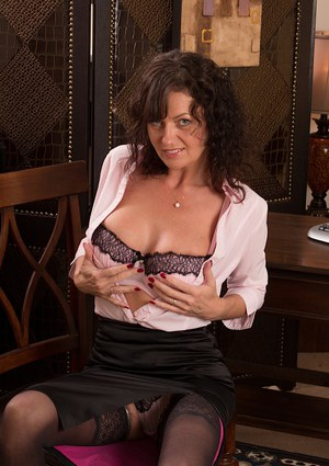 Mature brunette in stockings Lucy showing her big nipples and pussy