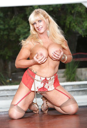 Fatty blonde with big boobs Zena Rey undressing and posing