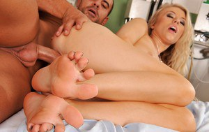 Stunning blonde girl with long legs Michelle gives a footjob