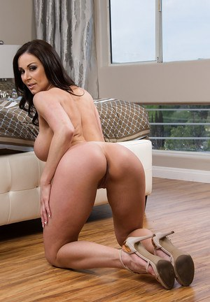 Big ass brunette bending over and spreading her shaved pussy