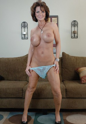 Mature babe Deauxma undressing her huge boobs and shaved pussy