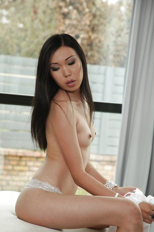 Nasty asian babe with small tits Nicoline poking that tight ass with a toy