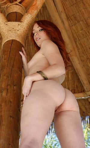 Stunning redhead girl Dani undressing her cute ass and pussy