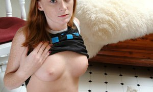 Sweet redhead amateur Allison playing with her shaved pussy