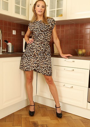 Sweet blonde milf with long legs Angel undressing in the kitchen