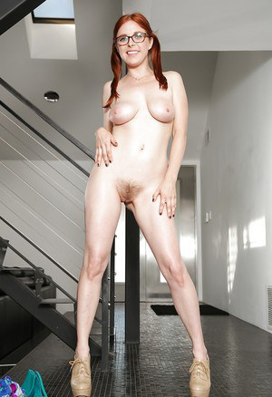 Redhead big tit babe Penny undressing her big ass and pretty body