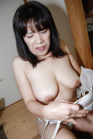 Nasty mature asian Yumiko masturbating that hairy asian pussy