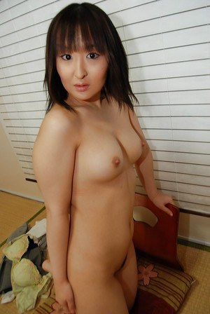 Asian milf babe Miki undressing and spreading that hairy pussy