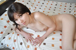 Stunning brunette asian milf Tomoyo undressing her sweet pussy