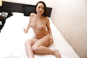 Pretty brunette asian milf Eriko showing that awesome sexy body