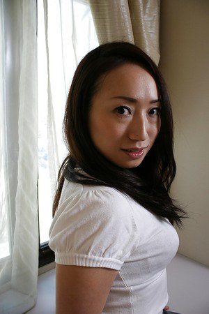 Wonderful brunette asian milf Eriko showing hairy pussy