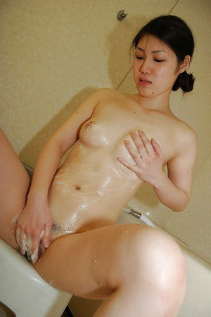 Awesome small tit Yui is washing her hairy pussy and pretty body