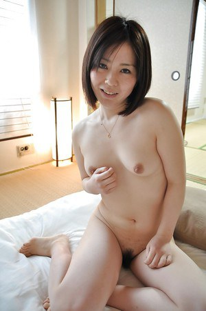Amazing brunette babe Eriko loves to undress that cute looking pussy