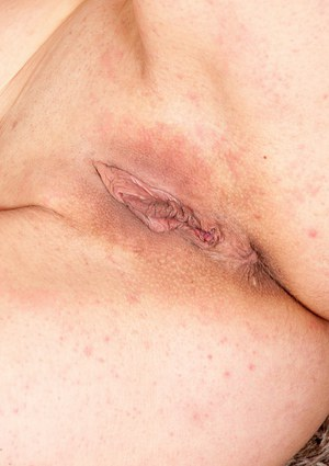Nasty mature slut Cristine showing her shaved pussy and big boobs