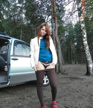 Pretty brunette slut with cute ass and tits is undressing outdoor