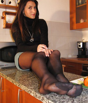 Brunette babe with sexy legs Valentina showing that body