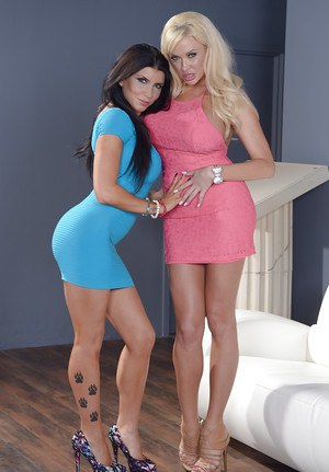 Brunette babe with big tits is having so much fun with her lesbian babe