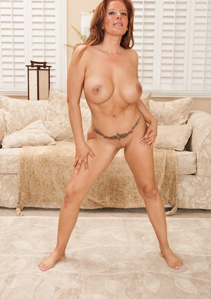 Nasty looking redhead milf Latina Nicky loves to undress