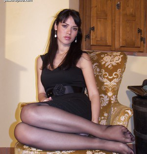While wearing a sexy black dress Aida shows her true foot nature