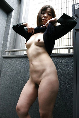 Masturbating mature Asian Kazue Hamano is shown doing it using a toy