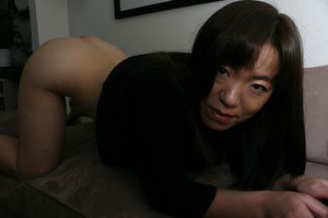 Clothed beauty Kazue Hamano is revealing her Asian hairy pussy in close up