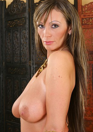 Milf chick with big tits Pandora showing her body in a golden outfit