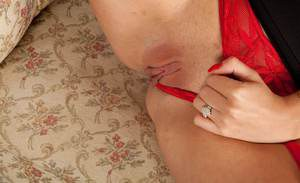 Charlie Z will make your dreams come true in her sexy red lingerie