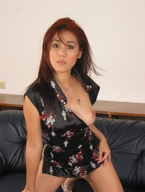 Asian babe Yu is teasing her big tits and spreading her legs in high heels