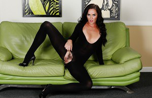 Brunette milf Bianca Breeze is spreading her slim legs in a black outfit