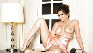 Big tits milf pornstar Sunny Leone is posing in a sweet pink lingerie