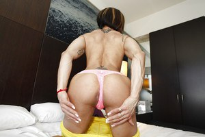 Big tits bodybuilder Karyn is flexing her muscles while posing naked