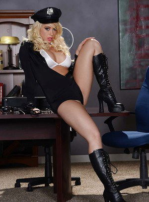 Kagney Linn Karter is posing in her sexy police uniform while in high heels