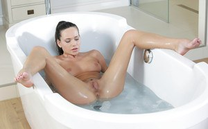 Subil Arch is taking a hot shower while teasing her wet vagina