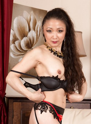 Stockings mature model Kim is demonstrating her Asian ass in a lingerie
