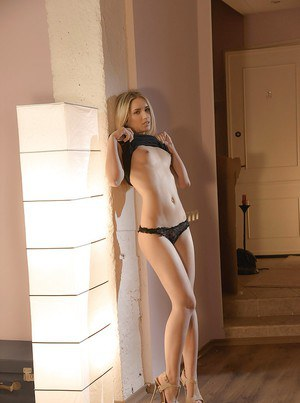 Jessi Gold is taking off her black panties after undressing her dress
