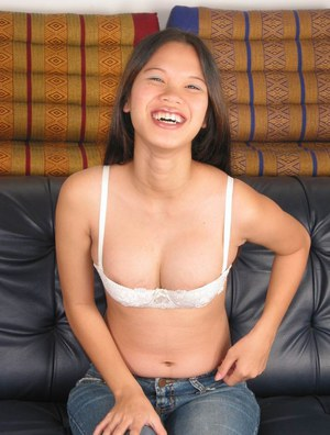 Kinky Asian slut taking off clothes and trying to be gentle with pussy