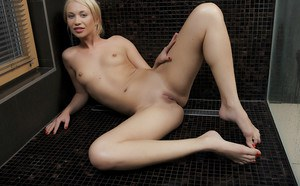Lendsay is posing naked while taking a hot shower in her bathroom
