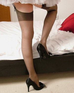 Clothed maid Rose is demonstrating her perfect legs in stockings