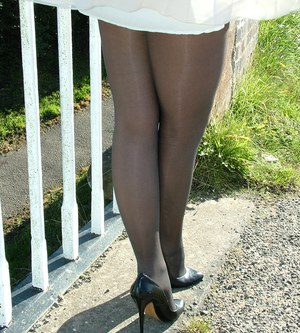 Non nude outdoor posing from a tremendous blondie in a tight skirt Erin