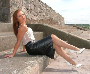 Linda is taking part in a non nude posing scene while in her skirt outdoor