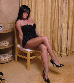 Brunette chick with slim legs Michelle is posing in her pantyhose